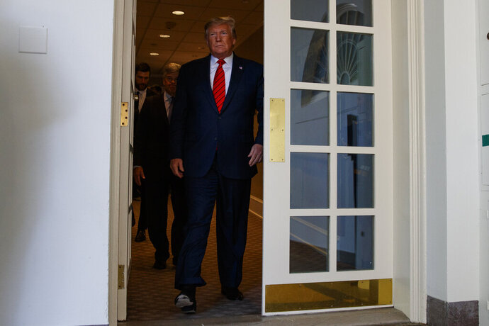 President Donald Trump arrives for an event to honor the 2019 Stanley Cup Champion St. Louis Blues, in the Rose Garden of the White House, Tuesday, Oct. 15, 2019, in Washington. (AP Photo/Evan Vucci)