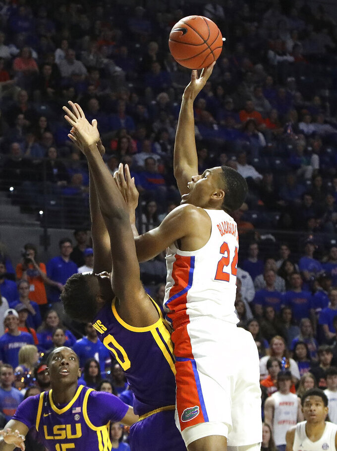 Florida forward Kenny Blackshear, Jr, goes to the hoop during an NCAA college basketball game against LSU, Wednesday, Feb. 26, 2020 in Gainesville, Fla.  (Brad McClenny/The Gainesville Sun via AP)