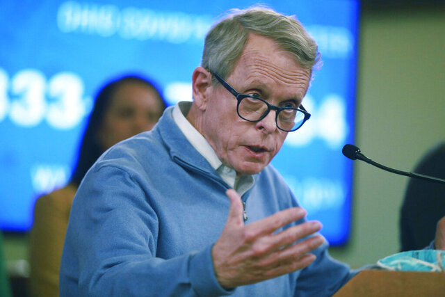 FILE—In this file photo from March 14, 2020, Ohio Gov. Mike DeWine speaks at a coronavirus news conference at the Ohio Statehouse in Columbus, Ohio. DeWine has issued a warning against Ohioans gathering for big events like weddings and funerals, while defending a decision to boost the number of fans allowed to attend NFL games in the state. The governor also said Thursday, Oct. 8, 2020 that even as cases rise in the state, the economy won't be shut down again. (Doral Chenoweth/The Columbus Dispatch via AP, File)