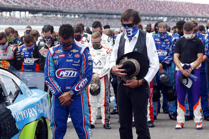 FILE - In this June 22, 2020, file photo, team owner Richard Petty, right, stands next to driver Bubba Wallace during the national anthem prior to the start of the NASCAR Cup Series auto race at the Talladega Superspeedway in Talladega, Ala. NASCAR is ready to embrace all genders, ethnicities and backgrounds as moves ahead in its push for racial diversity.  (AP Photo/John Bazemore, File)