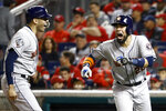 Houston Astros' Robinson Chirinos, right, celebrates his two-run home run with Carlos Correa during the fourth inning of Game 4 of the baseball World Series against the Washington Nationals Saturday, Oct. 26, 2019, in Washington. (AP Photo/Patrick Semansky)