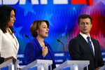 Democratic presidential candidate Sen. Amy Klobuchar, D-Minn., center speaks as Democratic presidential candidate Rep. Tulsi Gabbard, D-Hawaii, left and Democratic presidential candidate South Bend, Ind., Mayor Pete Buttigieg listen during a Democratic presidential primary debate, Wednesday, Nov. 20, 2019, in Atlanta. (AP Photo/John Bazemore)