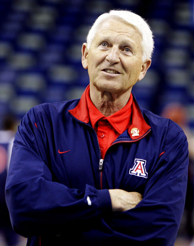 FILE - In this March 15, 2007, file photo, Arizona coach Lute Olson watches his team practice for the NCAA Midwest Regional basketball tournament in New Orleans. Olson, the Hall of Fame coach who turned Arizona into a college basketball powerhouse, has died at the age of 85. Olson's family said he died Thursday, Aug. 27, 2020. The family did not provide the cause of death. (AP Photo/Alex Brandon, File)