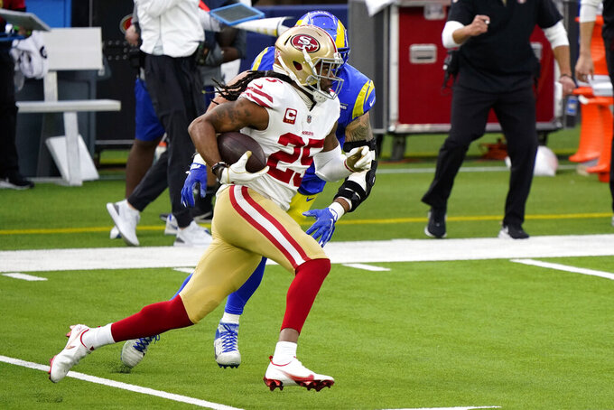 "FILE - In this Nov. 29, 2020, file photo, San Francisco 49ers cornerback Richard Sherman (25) runs with the ball after an interception, with Los Angeles Rams tight end Tyler Higbee in pursuit during the first half of an NFL football game in Inglewood, Calif. Sherman said it will likely take a ""miracle"" for him to return to the San Francisco 49ers next season because of the team's tight salary cap situation. Sherman is in the final year of a three-year contract he negotiated by himself with the 49ers after being released by Seattle in 2018. (AP Photo/Alex Gallardo, File)"