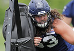 Seattle Seahawks center Joey Hunt hits a blocking sled as he runs a drill, Thursday, June 6, 2019, at the team's NFL football training facility in Renton, Wash. (AP Photo/Ted S. Warren)