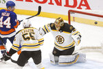 New York Islanders' Jean-Gabriel Pageau (44) scores a goal against Boston Bruins goalie Tuukka Rask (40), of Finland, during the third period of an NHL hockey game Monday, Jan. 18, 2021, in Uniondale, N.Y. (AP Photo/Jason DeCrow)