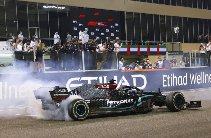 Mercedes driver Lewis Hamilton of Britain burns tires after the Formula One Abu Dhabi Grand Prix in Abu Dhabi, United Arab Emirates, Sunday, Dec. 13, 2020. (Giuseppe Cacace, Pool via AP)