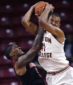 Boston College forward Steffon Mitchell, right, and Louisville center Malik Williams, left, battle for a rebound during the second half of an NCAA college basketball game in Boston, Wednesday, Feb. 27, 2019. (AP Photo/Charles Krupa)