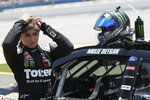 FILE - In this June 20, 2020, file photo, driver Hailie Deegan prepares to get in her car prior to the start of the ARCA auto race at the Talladega Superspeedway in Talladega Ala. Deegan was recently reprimanded and needed sensitivity training for using a demeaning word for the disabled in a virtual racing event. (AP Photo/John Bazemore, File)