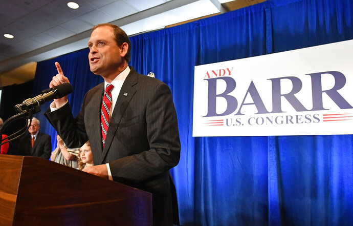 Rep. Andy Barr, R-Ky., speaks to his supporters at his victory celebration in Lexington, Ky., Tuesday, Nov. 6, 2018. (AP Photo/Timothy D. Easley)