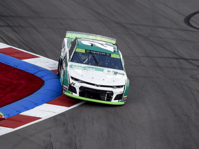 William Byron (24) drives through Turn 17 during a NASCAR Cup Series auto race at Charlotte Motor Speedway, Sunday, Sept. 29, 2019, in Concord, N.C. (AP Photo/Mike McCarn)