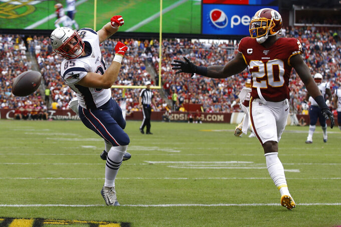 New England Patriots tight end Ryan Izzo (85) misses the catch against Washington Redskins strong safety Landon Collins (20) during the first half of an NFL football game, Sunday, Oct. 6, 2019, in Washington. (AP Photo/Patrick Semansky)