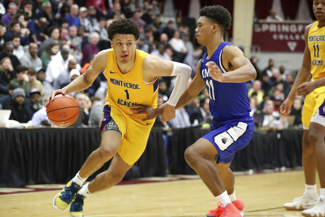 FILE - In this Jan. 19, 2020, file photo, then-Montverde Academy's Cade Cunningham (1) drives against an unidentified IMG Academy defender during a high school basketball game at the Hoophall Classic in Springfield, Mass. Oklahoma State could have a year to remember, even if it doesn't end in the NCAA Tournament. Freshman point guard Cade Cunningham, a preseason Associated Press All-American, stayed at Oklahoma State despite the NCAA banning the Cowboys from postseason play this season. (AP Photo/Gregory Payan, File)