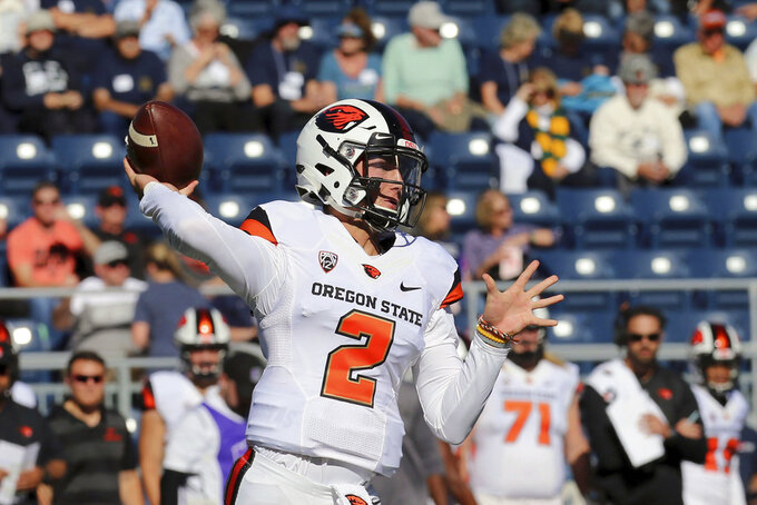 FILE - In this Sept. 15, 2018, file photo, Oregon State quarterback Conor Blount looks for a receiver during an NCAA college football game against Nevada in Reno, Nev. Oregon State quarterback Jake Luton is listed as doubtful for the team's home game against Arizona on Saturday, Sept. 22, because of an ankle sprain, so it's likely that Blount will start. (AP Photo/Lance Iversen, File)
