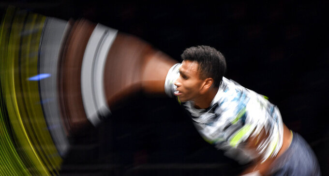 Canada's Felix Auger-Aliassime serves the ball during his ATP bett1HULKS Indoors tennis final against Germany's Alexander Zverev in Cologne, Germany, Sunday, Oct. 18, 2020. (AP Photo/Martin Meissner)