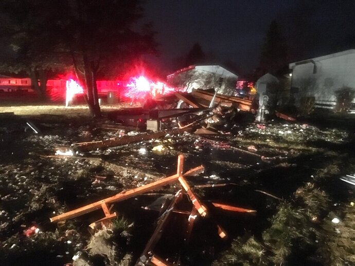 Several trailers are damaged from a powerful storm Thursday, March 14, 2019 at Camelot Villas mobile home park in Genesee Township, Mich.  Authorities say a tornado swept through mid-Michigan, damaging homes and knocking out power to thousands.  (Roberto Acosta/The Flint Journal via AP)