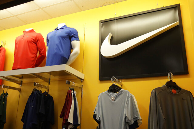 FILE - In this Nov. 29, 2019, file photo Nike clothes are displayed at a Kohl's store in Colma, Calif. Nike Inc. reports earnings on Thursday, Dec. 19. (AP Photo/Jeff Chiu, File)