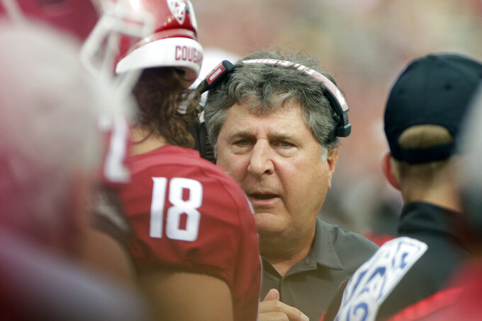 Washington State head coach Mike Leach, center, speaks with his players during the first half of an NCAA college football game against Northern Colorado in Pullman, Wash., Saturday, Sept. 7, 2019. (AP Photo/Young Kwak)