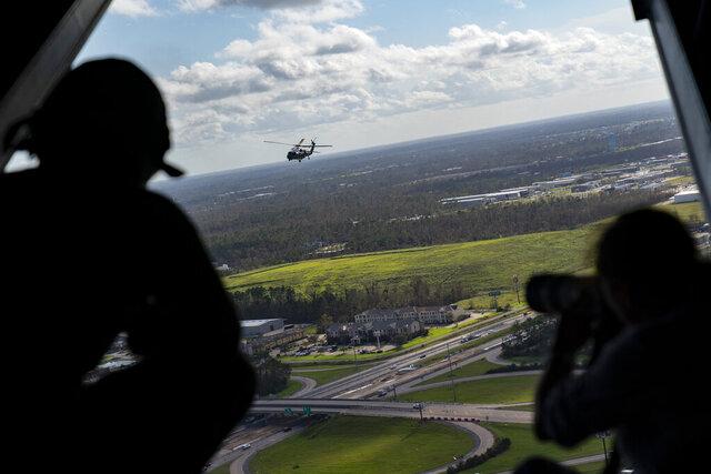 Marine One, with President Donald Trump aboard, flies over damage from Hurricane Laura, Saturday, Aug. 29, 2020, near Lake Charles, La. (AP Photo/Alex Brandon)