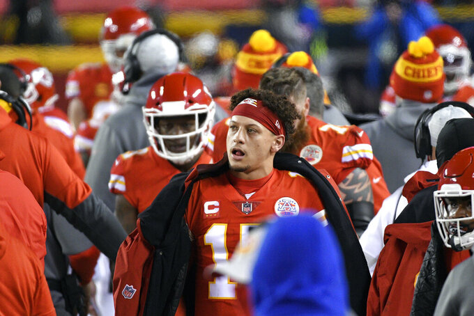 Kansas City Chiefs quarterback Patrick Mahomes walks on the sideline during the first half of the AFC championship NFL football game against the Buffalo Bills, Sunday, Jan. 24, 2021, in Kansas City, Mo. (AP Photo/Reed Hoffmann)