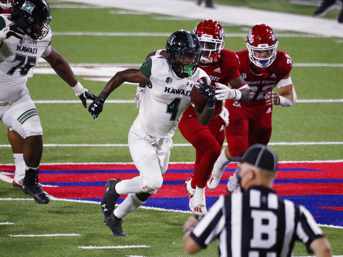 Hawaii running back Miles Reed runs past the Fresno State line for a large gain during the second half of an NCAA college football game in Fresno, Calif., Saturday, Oct. 24, 2020. Hawaii won 34-19. (AP Photo/Gary Kazanjian)