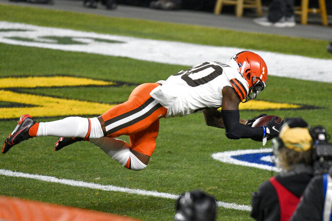 Cleveland Browns wide receiver Jarvis Landry (80) dives into the end zone for a touchdown during the first half of an NFL wild-card playoff football game against the Pittsburgh Steelers in Pittsburgh, Sunday, Jan. 10, 2021. (AP Photo/Don Wright)