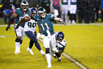 Philadelphia Eagles' Carson Wentz (11) is grabbed by Seattle Seahawks' Poona Ford (97) during the second half of an NFL football game, Monday, Nov. 30, 2020, in Philadelphia. (AP Photo/Chris Szagola)
