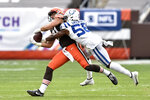 Cleveland Browns tight end Austin Hooper (81) catches the ball for a first down under pressure from Indianapolis Colts inside linebacker Bobby Okereke (58) during the first half of an NFL football game, Sunday, Oct. 11, 2020, in Cleveland. (AP Photo/David Richard)