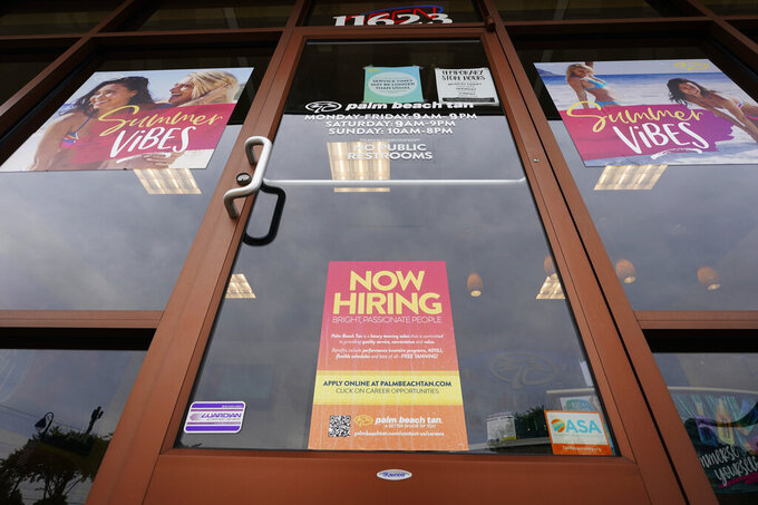 FILE - A Now Hiring sign at a business in Richmond, Va., Wednesday, June 2, 2021. U.S. employers posted a record 10.1 million job openings in June, another sign that the job market and economy are bouncing back briskly from last year's coronavirus shutdowns. The Labor Department reported Monday, Aug. 9, 2021 that job openings rose from 9.5 million in May. (AP Photo/Steve Helber)