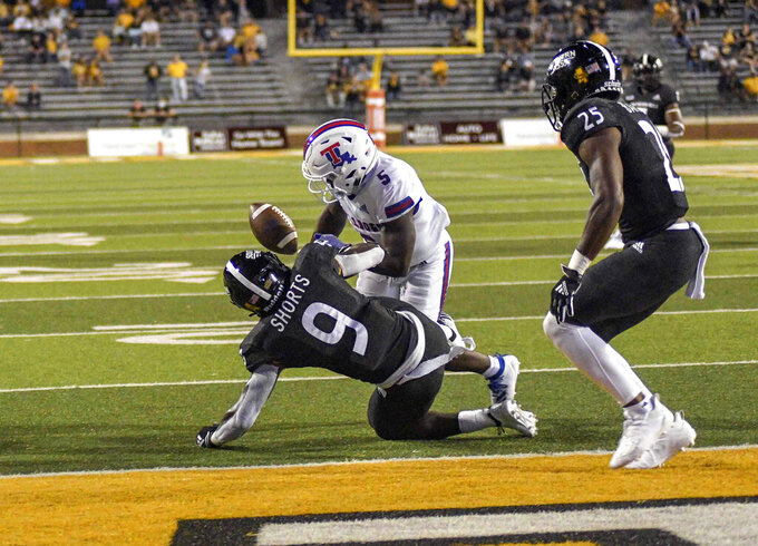 Southern Mississippi defensive back Malik Shorts (9) blocks a pass by Louisiana Tech quarterback Aaron Allen (3) to wide receiver Smoke Harris (5) during an NCAA college football game in Hattiesburg, Miss., Saturday, Sept. 19, 2020. (Cam Bonelli/Hattiesburg American via AP)