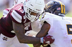 Mississippi State cornerback Tyler Williams (13) tackles Southern Mississippi wide receiver Tim Jones during the first half of an NCAA college football game Saturday, Sept. 7, 2019, in Starkville, Miss. (AP Photo/Jim Lytle)