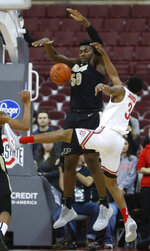 Purdue's Trevion Williams, left, blocks the shot of Ohio State's C.J. Jackson during the first half of an NCAA college basketball game Wednesday, Jan. 23, 2019, in Columbus, Ohio. (AP Photo/Jay LaPrete)