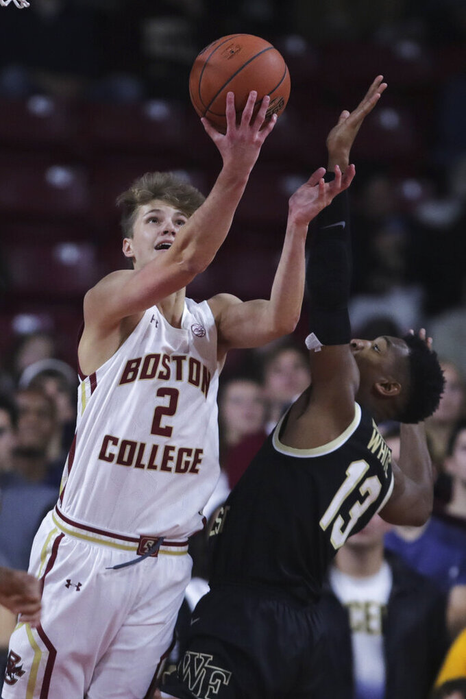 Boston College guard Julian Rishwain (2) throws up a shot against Wake Forest guard Andrien White (13) during the first half of an NCAA college basketball game in Boston, Wednesday, Nov. 6, 2019. (AP Photo/Charles Krupa)