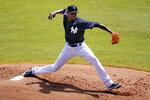 New York Yankees' pitcher Domingo German delivers during the first inning of a spring training exhibition baseball game against the Philadelphia Phillies in Tampa, Fla., Monday, March 15, 2021. (AP Photo/Gene J. Puskar)