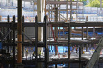 Workers are shown on multiple levels of the Climate Pledge Arena, Tuesday, Sept. 1, 2020, in Seattle, the home of the Seattle Kraken NHL hockey team. Sometime in the late summer or early fall of 2021, the Kraken will open the new facility -- at a cost that will likely total $1 billion by the time it's done -- and become the NHL's 32nd franchise. (AP Photo/Ted S. Warren)