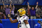 LSU wide receiver Justin Jefferson (2) celebrates a touchdown catch against Oklahoma safety Justin Broiles (25) during the first half of the Peach Bowl NCAA semifinal college football playoff game, Saturday, Dec. 28, 2019, in Atlanta. (AP Photo/Danny Karnik)