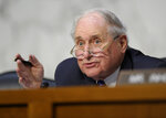 FILE - In this June 4, 2013, file photo, Senate Armed Services Committee Chairman Sen. Carl Levin, D-Mich. asks a question of a witness during a hearing on Capitol Hill in Washington on legislation regarding sexual assaults in the military. Former Sen. Carl Levin, a powerful voice for the military during his career as Michigan's longest-serving U.S. senator, has died. The Democrat was 87. Levin's family says Levin died Thursday, July 29, 2021. (AP Photo/Susan Walsh, File)