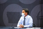 Kevin Kregel, interim provost and executive vice president, wears a face mask while speaking during a news conference amid the novel coronavirus pandemic, Monday, Aug. 10, 2020, at the Iowa Memorial Union on the University of Iowa campus in Iowa City, Iowa. (Joseph Cress/Iowa City Press-Citizen via AP)