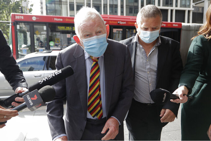 New Zealand businessmen Ron Brierley arrives at the Local Downing Centre Court in Sydney, Thursday, Oct. 14, 2021, to be sentenced for possessing child sex abuse images. Brierley, one of New Zealand's most well-known businessmen, was sentenced to 14 months in prison for possessing child sex abuse images. (AP Photo/Rick Rycroft)