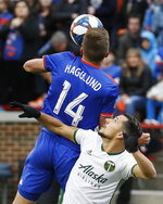 FC Cincinnati defender Nick Hagglund (14) heads the ball against Portland Timbers midfielder Sebastian Blanco (10) in the first half of an MLS soccer match, Sunday, March 17, 2019, in Cincinnati. (AP Photo/John Minchillo)