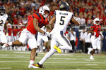 California quarterback Brandon McIlwain (5) scores a 25-yard touchdown while being defended by Arizona safety Scottie Young Jr. (19) during the first half of an NCAA college football game Saturday, Oct. 6, 2018, in Tucson, Ariz. (AP Photo/Chris Coduto)