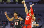 Houston guard Quentin Grimes (24) watches his three-point shot-attempt as Texas Tech guard Chibuzo Agbo (23) looks on during the second half of an NCAA college basketball game, Sunday, Nov. 29, 2020, in Fort Worth, Texas. (AP Photo/Ron Jenkins)