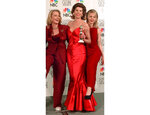 "FILE - Cast members from ""Cybill,"" from left, Cybill Shepherd, Christine Baranski and DeeDee Pfeiffer appear at the Golden Globe Awards in Beverly Hills, Calif. on Jan. 21, 1996. The show won best television series, music or comedy. The Bob Mackie gown Baranski wore to the awards show is among the items being auctioned for an online charity auction on Wednesday. (AP Photo/Mark J. Terrill, File)"