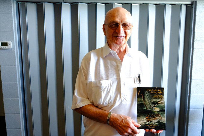 """In this Frank Mays September 2018 photo Frank Mays holds his book """"If We Make it 'till Daylight"""" at the Dossin Great Lakes Museum in Detroit. A memorial Mass has been held in northern Michigan for Mays, the last remaining survivor of a Lake Michigan shipwreck that killed 33 people in 1958. Mays was one of two people who survived the sinking of the Carl D. Bradley Mays, 89, died on Jan. 7 in Zephyrhills, Florida. A memorial Mass was held Monday, Aug. 2, 2021 in Rogers City, his hometown.(Sarah Rahal/Detroit News via AP)"""
