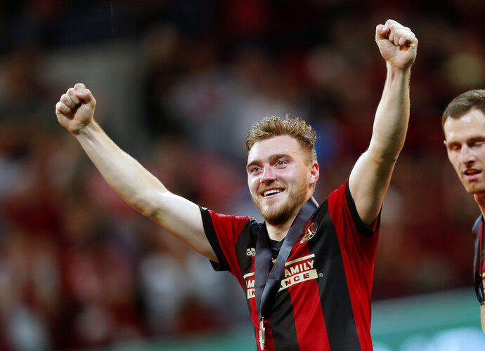 FILE - In this Saturday, Dec. 8, 2018 file photo, Atlanta United defender Julian Gressel (24) reacts as he makes his way onstage for the trophy presentation after defeating the Portland Timbers 2-0 to win during the MLS Cup soccer championship in Atlanta. Atlanta United surrendered another big part of its MLS Cup-winning squad, trading midfielder Julian Gressel to D.C. United on Tuesday, Jan. 21, 2020 after failing to reach agreement on a new contract. (AP Photo/John Bazemore, File)