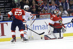The puck gets past Florida Panthers goaltender Sam Montembeault (33) on a goal scored by Edmonton Oilers defenseman Adam Larsson, not shown, as right wing Kailer Yamamoto (56) looks on during the first period of an NHL hockey game, Saturday, Feb. 15, 2020, in Sunrise, Fla. (AP Photo/Lynne Sladky)