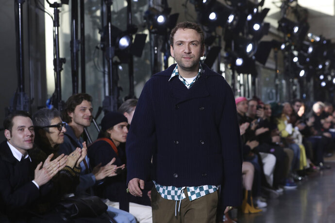 Creative director Bruno Sialelli walks on the stage after the presentation of Lanvin Mens Fall/Winter 2020-2021 fashion collection Sunday, Jan. 19, 2020 in Paris. (AP Photo/Thibault Camus)