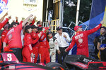 Marcus Ericsson makes a selfie with his team in Victory Circle during the IndyCar Music City Grand Prix auto race Sunday, Aug. 8, 2021, in Nashville, Tenn. (AP Photo/Harrison McClary)
