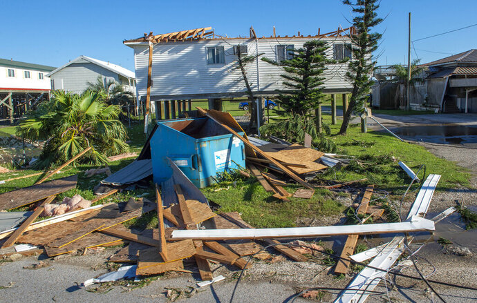 A home missing a roof due to Hurricane Zeta damage is viewed Thursday, Oct. 29, 2020, in Grand Isle, La., as part of Gov. John Bel Edwards flyover of stricken areas in the southeastern part of the state. (Bill Feig/The Advocate via AP)