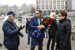 In this Nov. 11, 2018, photo provided by the U.S. Embassy in Kyiv, Energy Secretary Rick Perry talks with Michael Bleyzer, left, and then-U.S. ambassador to Ukraine Marie Yovanovitch as Perry prepares to place flowers at the Heavenly Hundred Memorial in Kyiv, Ukraine. Bleyzer and Alex Cranberg, two political supporters of Perry secured a potentially lucrative oil-and-gas exploration deal from the Ukrainian government soon after Perry proposed one of the men as an adviser to the country's new president.(U.S. Embassy Kyiv via AP)